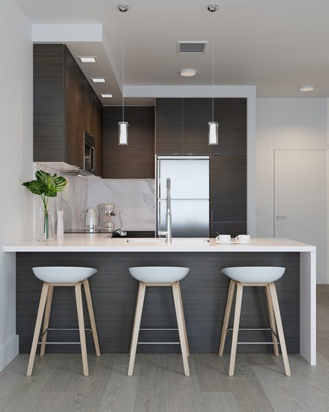 Kiitchen with Dark Finishes featuring Island with Waterfall Edge, Stainless Steel Whirlpool Appliances  Arrowwood, North Bethesda, 20852