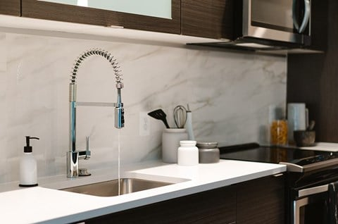 Kitchen - Elevated Finishes at Arrowwood Apartments in North Bethesda, MD 20852
