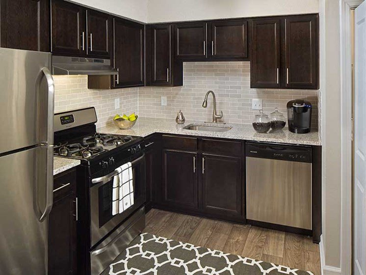 Espresso Cabinetry with Stainless Steel Appliances at Paces Ridge at Vinings 30339