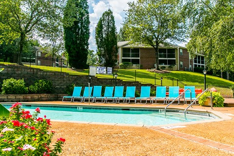 Waterford Apartments pool view with lounge chairs
