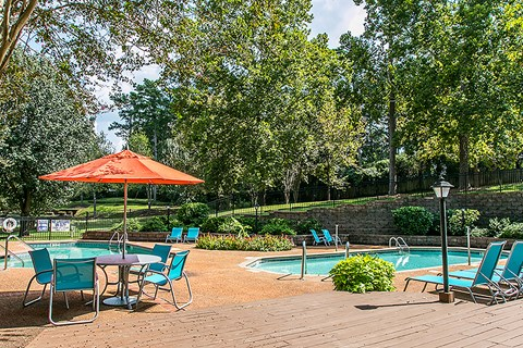Waterford Apartments pool with seating area
