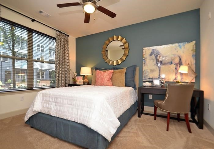 @1377 model bedroom with window view and accent wall