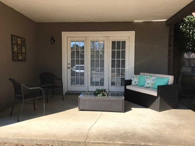 French doors opening to a spacious private veranda at The Addison at Collierville Apartments, Collierville, TN 38017