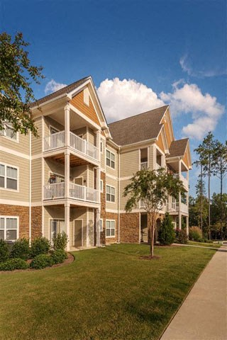 Bright Apartment Home Exteriors with Trees Inviting You Inside Ashby at Ross Bridge, Hoover, AL 35226