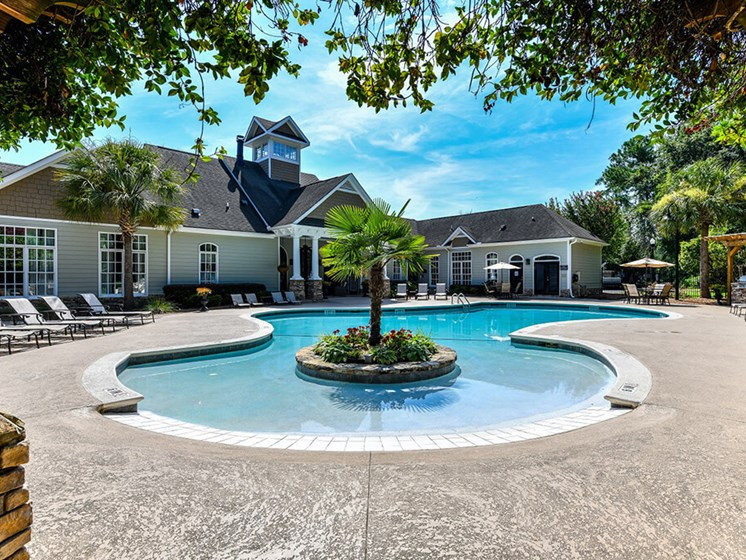 Revitalizing Pool with Relaxation Space and Seating Area at Legends at Charleston Park Apartments, North Charleston, SC, 29420