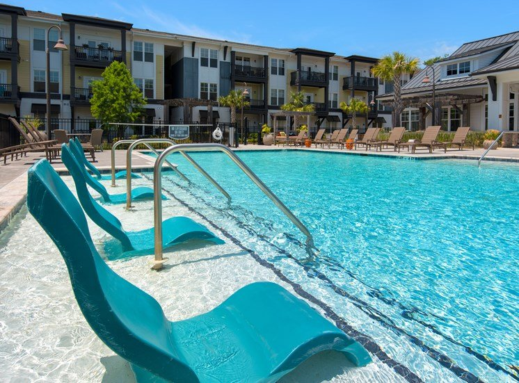 Resident Pool and lounge chairs at Spyglass Seaside