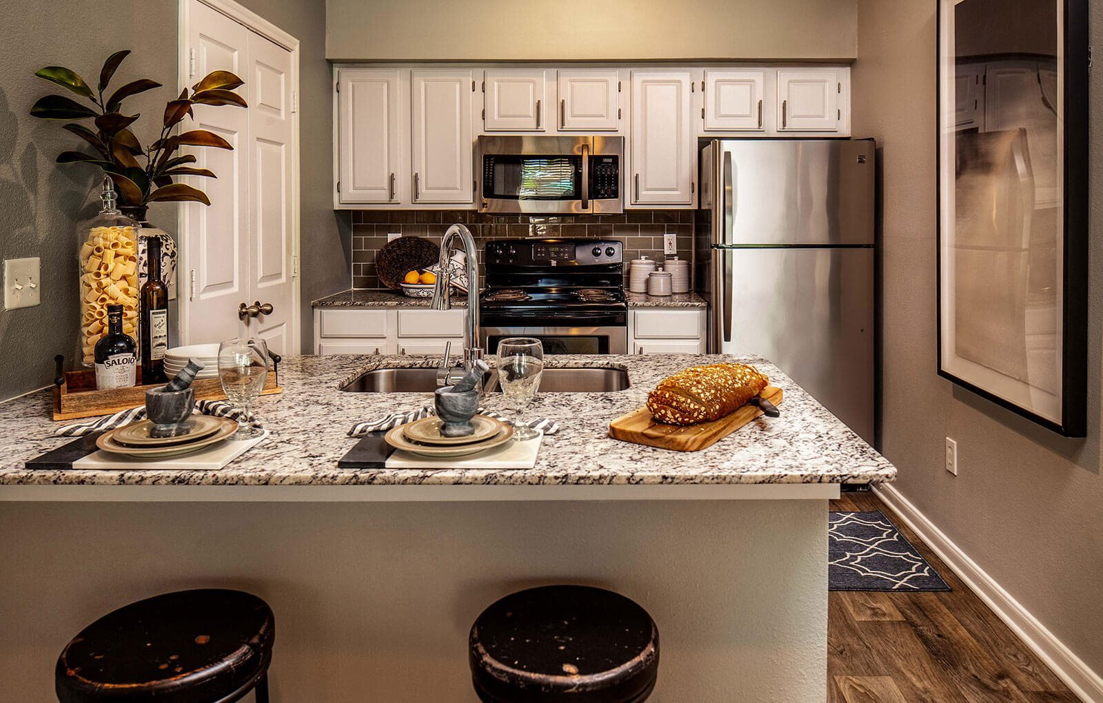 Furnished kitchen model with fridge and stove