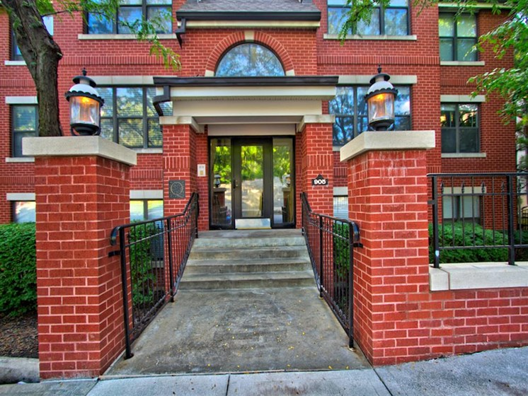 Entrance to brick building with columns and steps-Quality Hill Square, Kansas City, MO