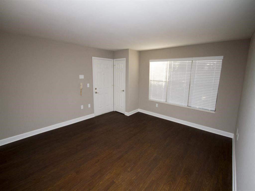 Apartment bedroom with hardwood floors-Quality Hill Square, Kansas City, MO