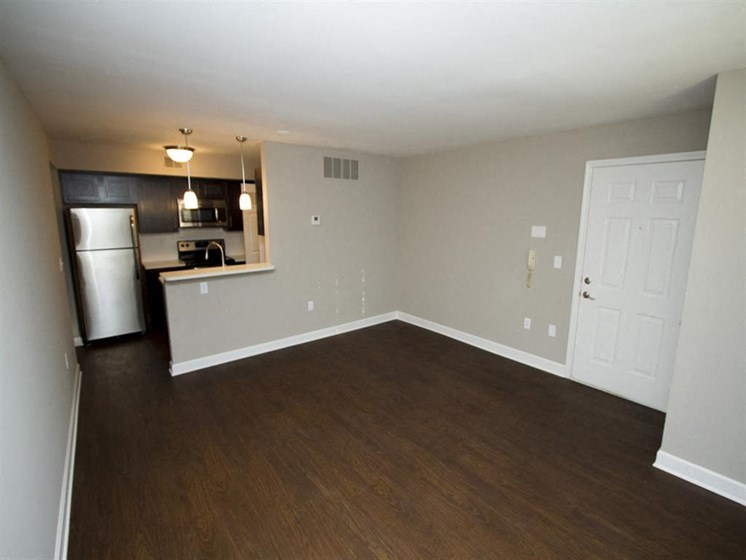 Apartment living room area with hardwood floors-Quality Hill Square, Kansas City, MO