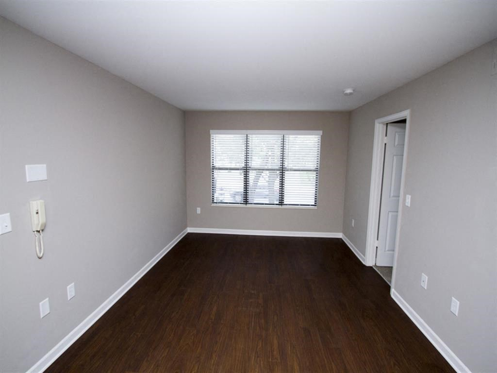 Apartment living area with hardwood floors-Quality Hill Square, Kansas City, MO