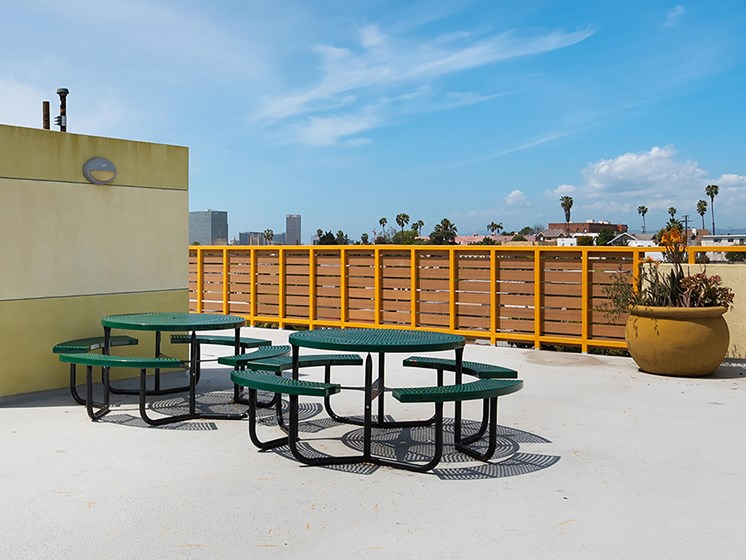 Rooftop patio seating area-Magnolia on Lake Apartments, Los Angeles, CA
