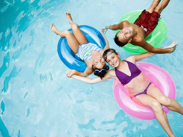 kids in outdoor pool-Quimby Plaza Apartments Memphis, TN