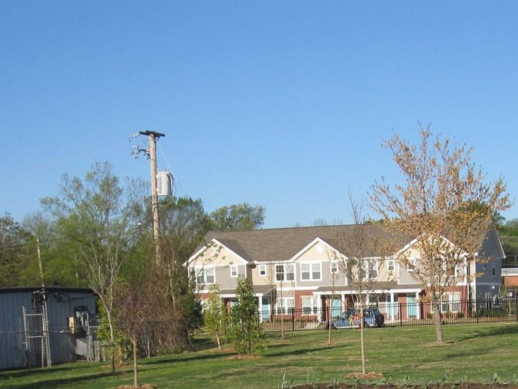 Garden area and exterior of apartment building-Metropolitan Village and Cumberland Manor Apartments, Little Rock, AR