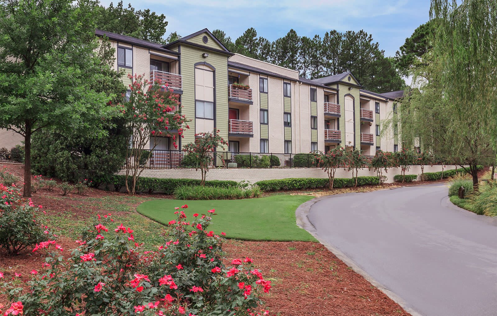 Apartment building exterior and landscape at Park on Windy Hill in Marietta, GA.