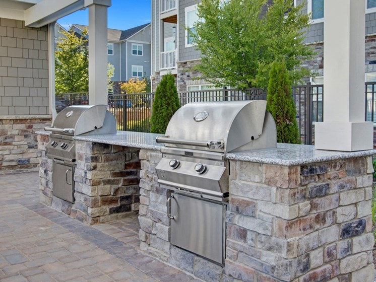 Outdoor grilling. Grill, countertops, seating and seating. at York Woods at Lake Murray Apartment Homes, Columbia