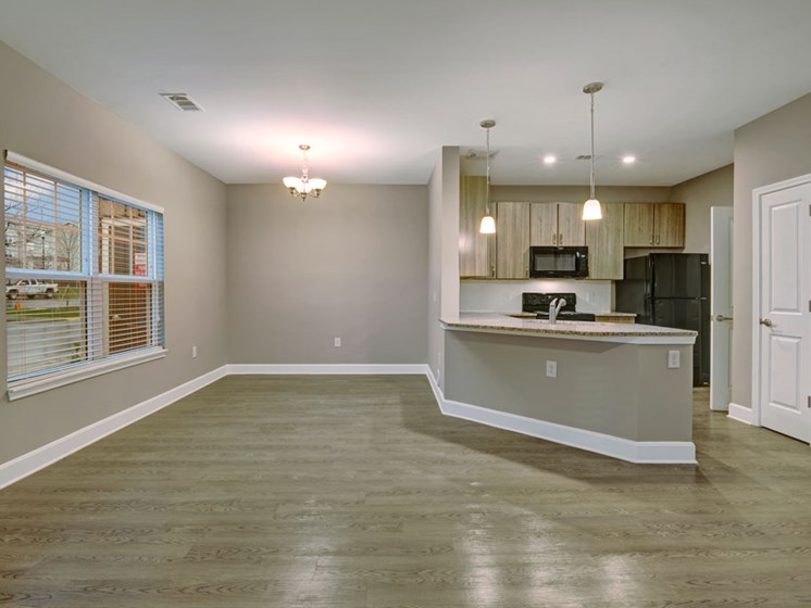 Spacious living room with an open concept to the kitchen at York Woods at Lake Murray Apartment Homes, South Carolina, 29212