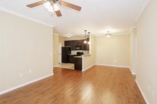 Hardwood style flooring in select units