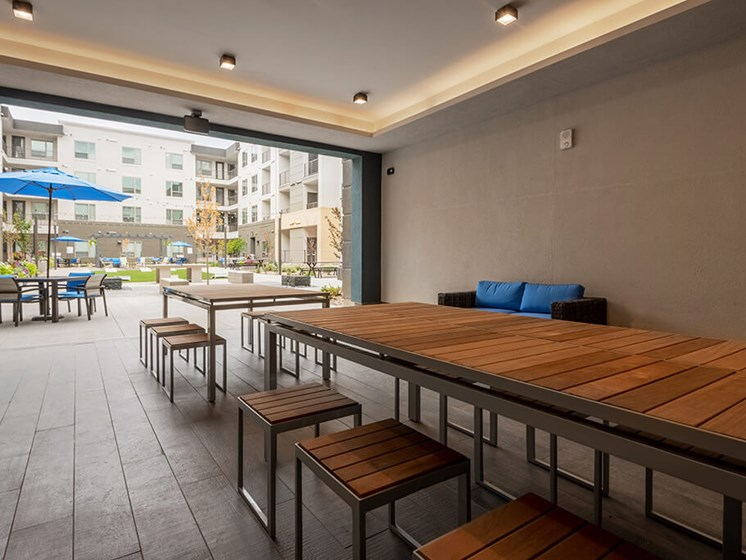 Expansive outdoor gathering space at Encore Boulevard One Apartments, 7108 E Lowry Boulevard, CO