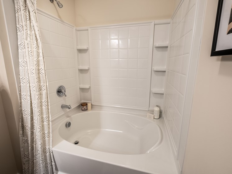 Oval Tub With Combo Shower at Abberly CenterPointe Apartment Homes by HHHunt, Midlothian