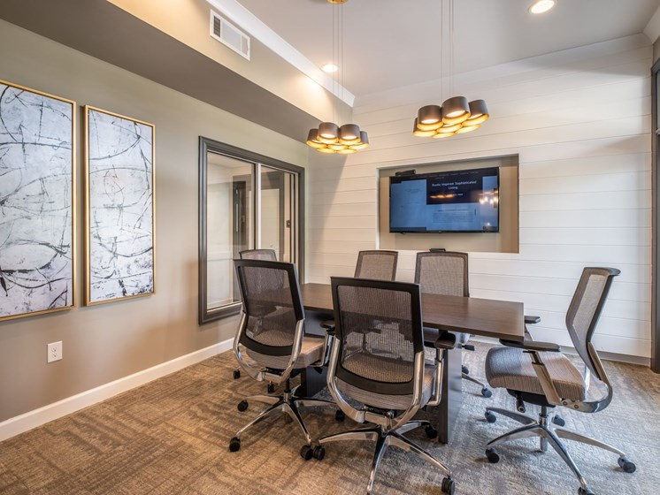 Conference Room With Television at Abberly CenterPointe Apartment Homes by HHHunt, Midlothian, Virginia