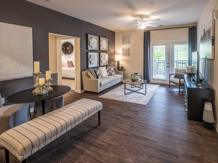 Living Room With Oversized Windows And Doors at Abberly CenterPointe Apartment Homes by HHHunt, Virginia
