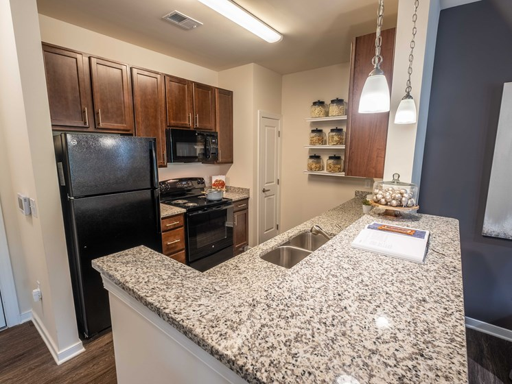 Granite Kitchen Worktops at Abberly CenterPointe Apartment Homes by HHHunt, Midlothian, VA