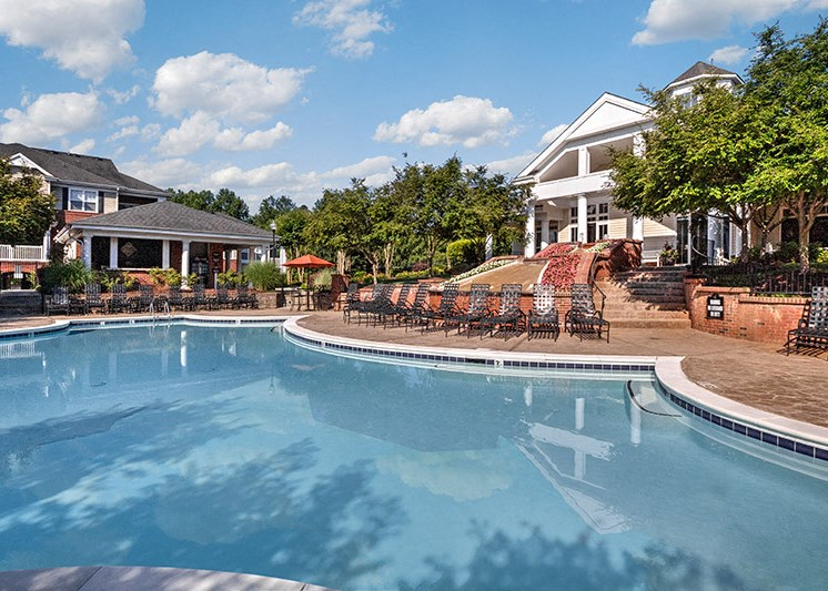 Take a dip in our resort-style swimming pool at Abberly Green Apartment Homes by HHHunt, Mooresville, 28117