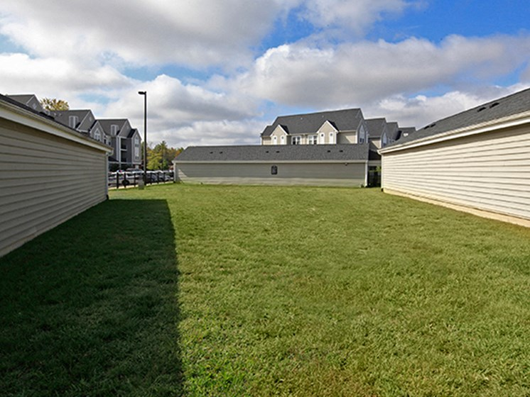 Beautifully Landscaped Grounds at Abberly Crest Apartment Homes by HHHunt, Lexington Park
