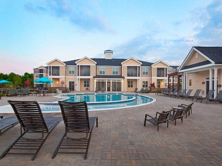 Swimming Pool with Lounge Chairs at Abberly Crest Apartment Homes by HHHunt, Maryland