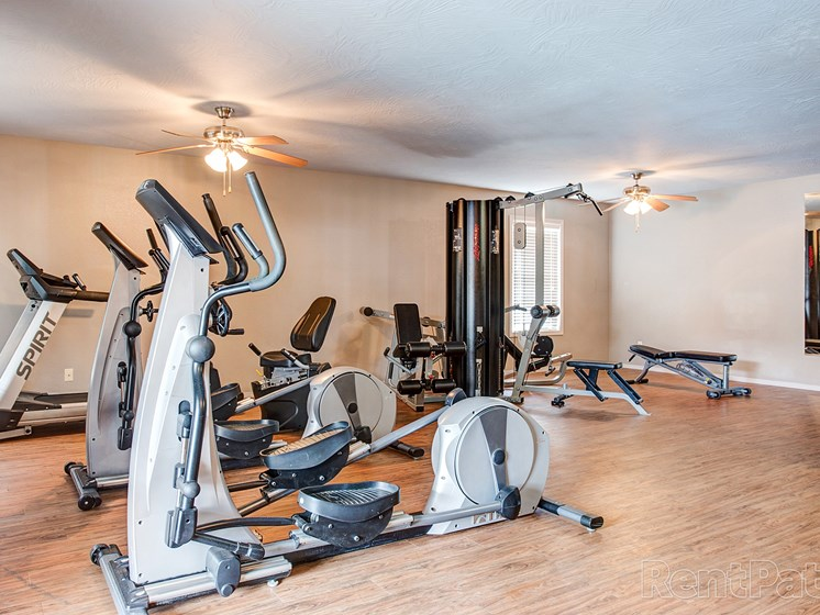 Fitness center with exercise machines at Quail Creek Apartments