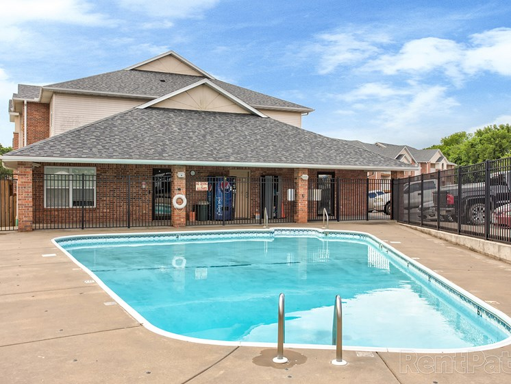 Swimming pool and clubhouse at Quail Creek Apartments