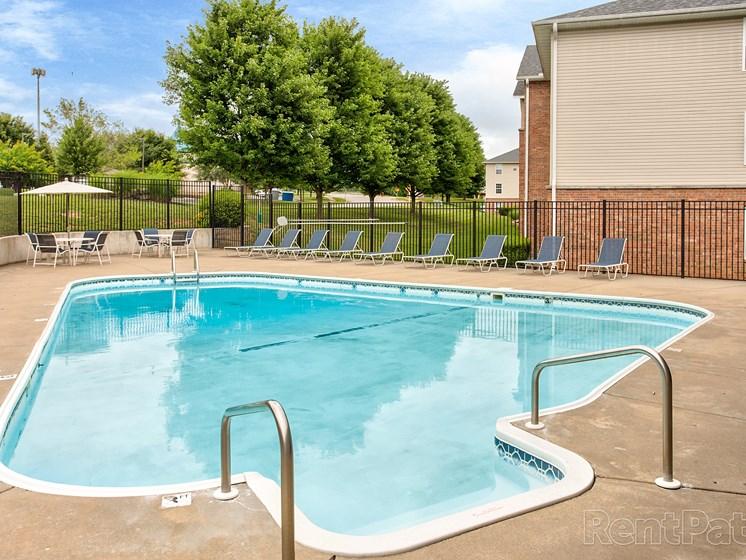 Clear blue swimming pool at Quail Creek Apartments