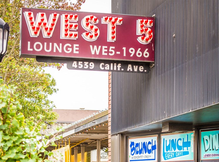 West 5 Lounge Neon Sign on Building