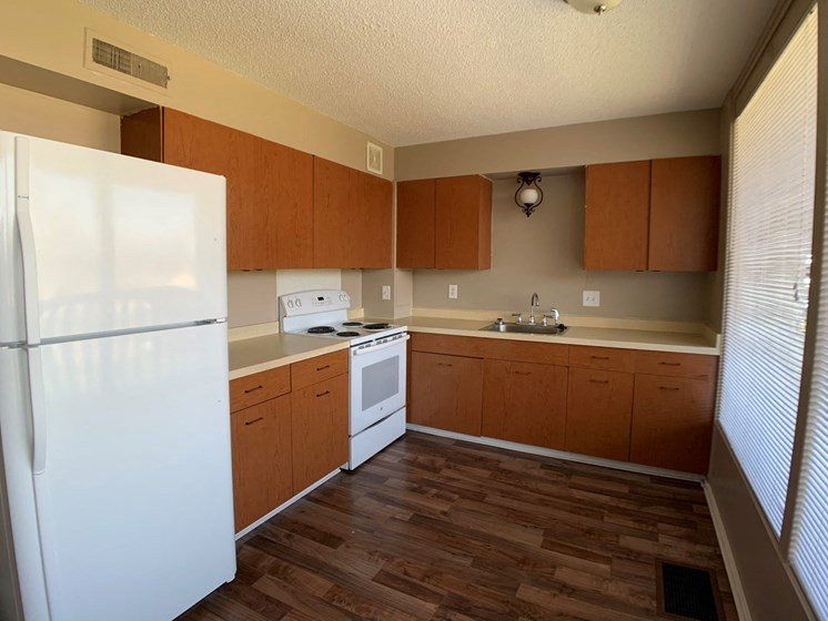 Kitchen with refrigerator, oven, and abundant cabinets