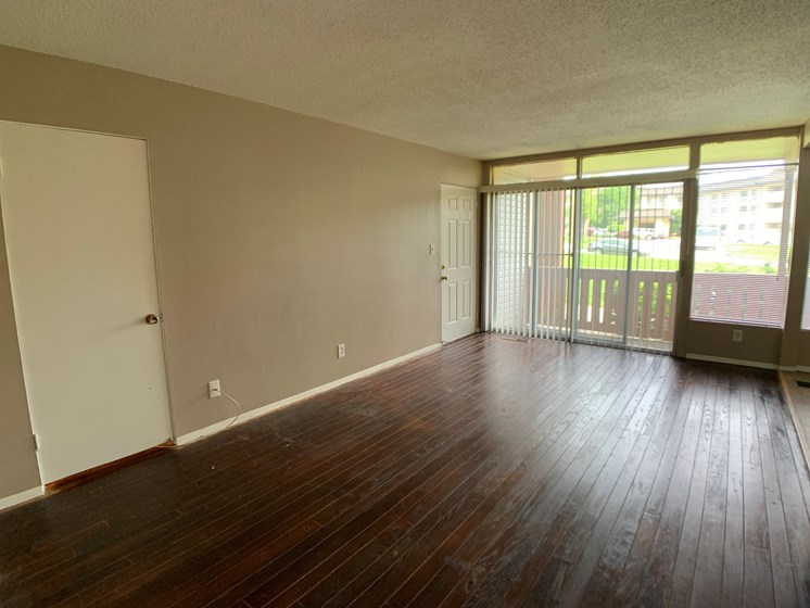 large living room with hardwood floor
