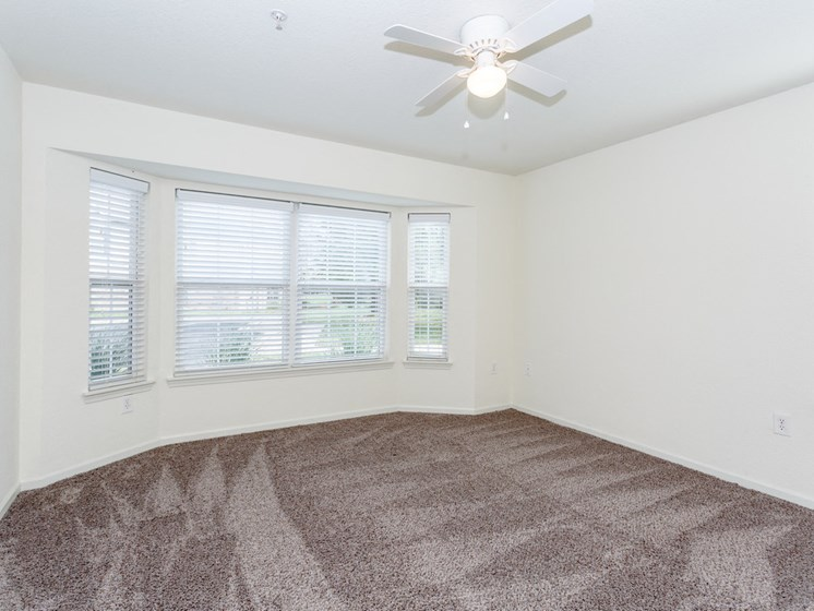 Carpeted bedroom with bay window