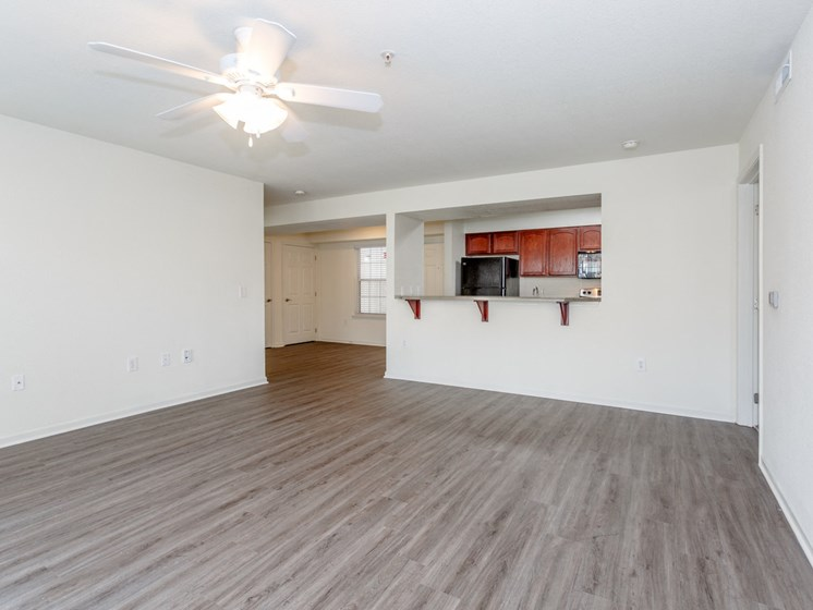 Living room with view into kitchen