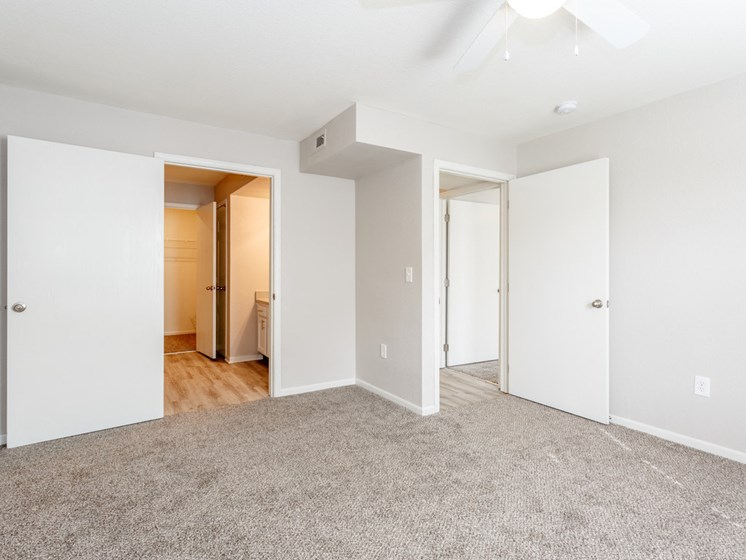 Master bedroom with private bathroom and walk in closet