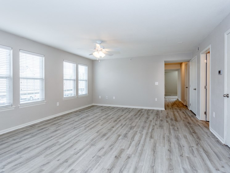 Living room with vinyl plank flooring and windows