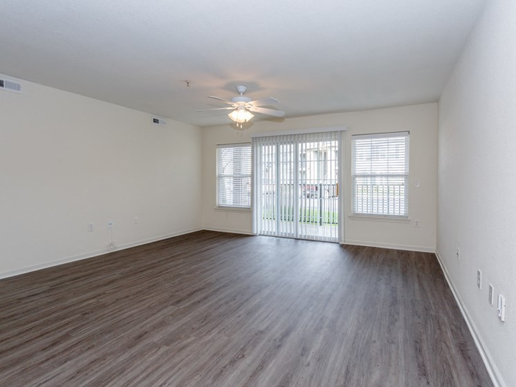 Living room with vinyl plank flooring and patio