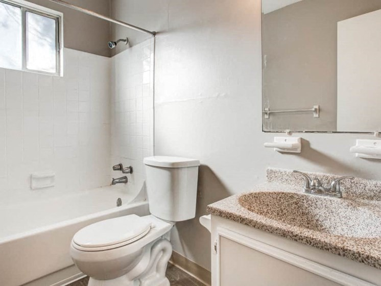 Bathroom with full shower and vanity