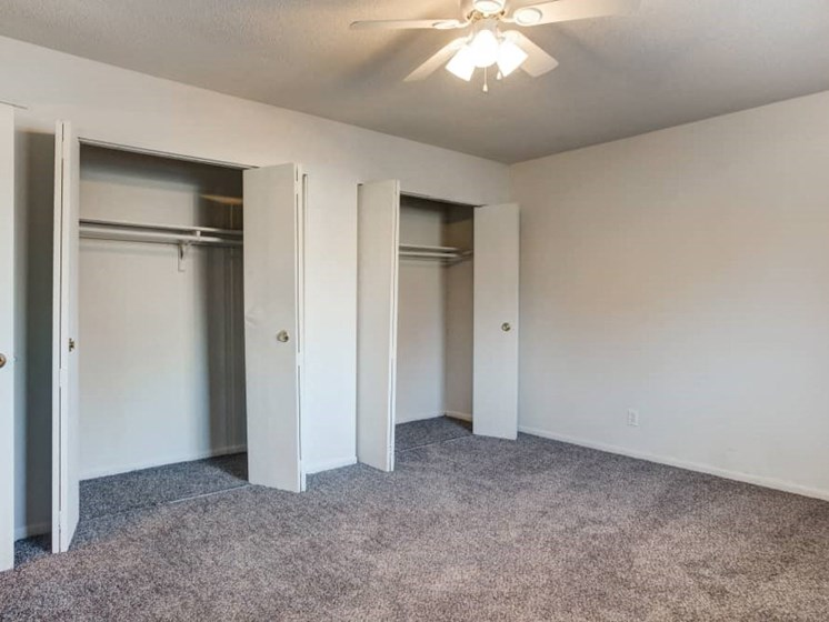 Interior view of bedroom with two large closets
