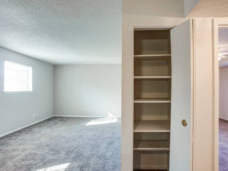 View of living room and linen closet