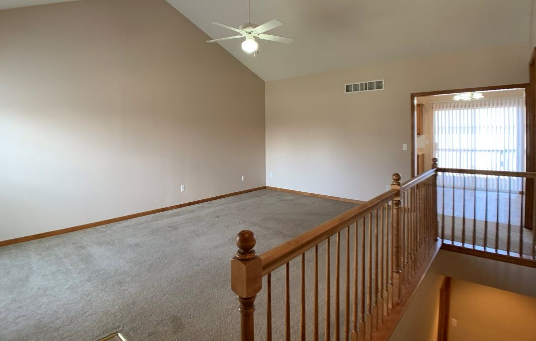 carpeted living room and stairs