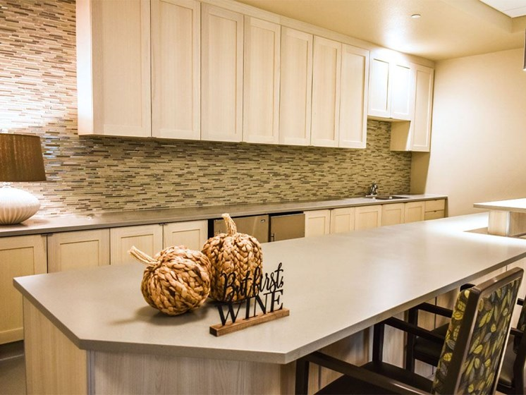 Breakfast bar with pendent lighting at Westmont of Milpitas, Milpitas