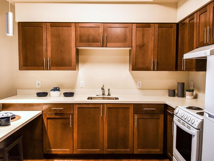 Fully Furnished Kitchen With Stainless Steel Appliances at Westmont of Milpitas, Milpitas