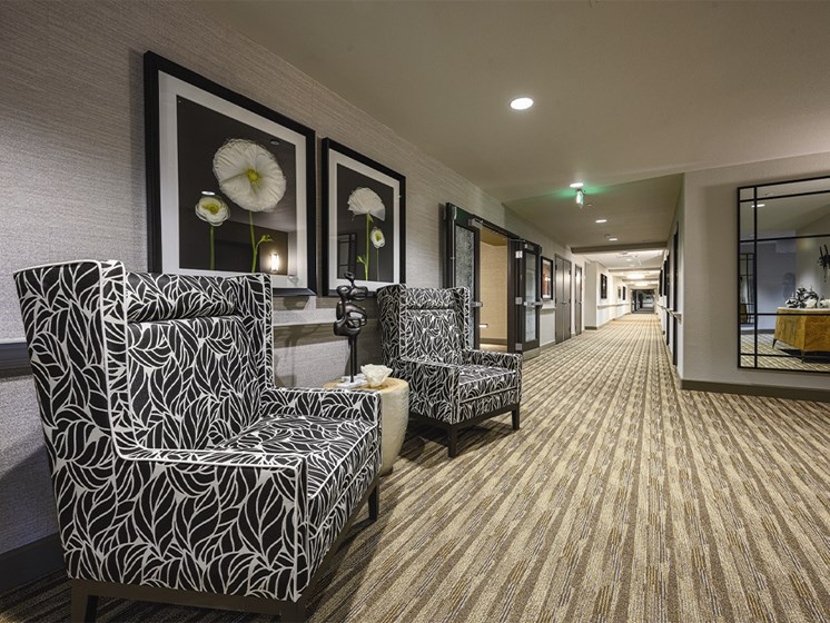 Passage with sofas and wall frames at The Oaks at Paso Robles, Paso Robles, 93446