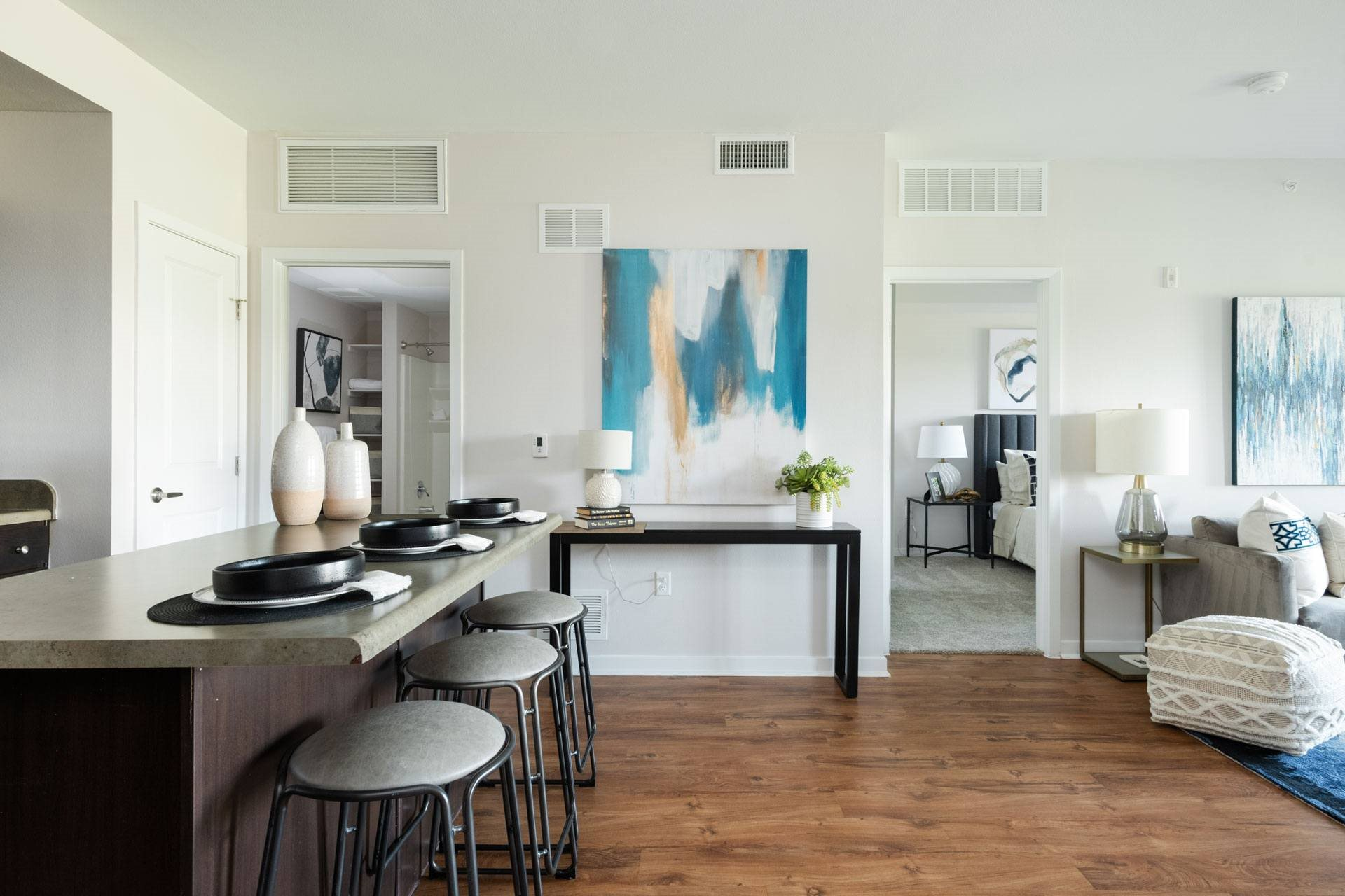 Modern Living Room with Abstract Paintings at Arbour Commons, Westminster, Colorado