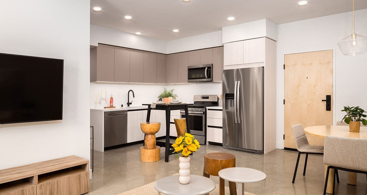 Two bedrooms with two-toned cabinets